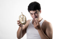 Asian man eating Durian Royalty Free Stock Photography