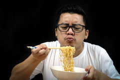 Asian man eating Instant noodles Stock Photo