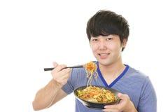 Asian man eating meal Royalty Free Stock Photo