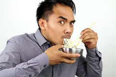 Asian man eating noodles Stock Photo