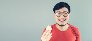 Asian man is eating. Royalty Free Stock Photos