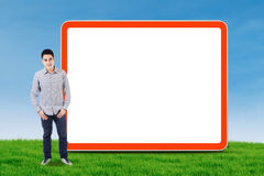 Asian man and empty billboard Royalty Free Stock Image