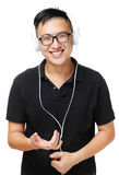 Asian man enjoy listen to music. Isolated on white Royalty Free Stock Photography
