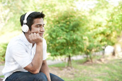 Asian Man enjoying white headphones Royalty Free Stock Photo