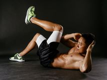 Asian man exercising his stomach muscles Royalty Free Stock Photo