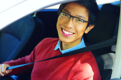 Asian man fastening seat belt Stock Images