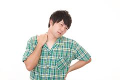 Asian man having a shoulder pain stock photo
