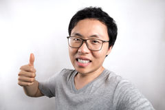Asian man feels happy. Isolated Royalty Free Stock Images