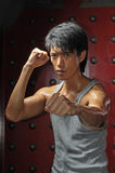 Asian Man In Fighting Action Stock Images