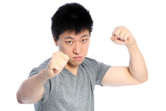 Asian man fighting Royalty Free Stock Images
