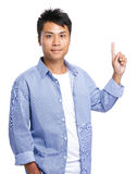 Asian man finger point up Stock Image