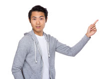 Asian man with finger point upwards Royalty Free Stock Images