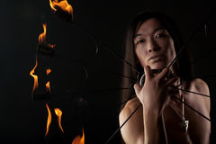 Asian man with fire show Stock Image