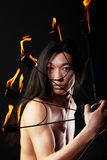 Asian man with fire show Royalty Free Stock Photos
