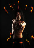 Asian man with fire show Stock Photography