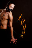 Asian man with fire show Stock Photos