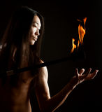 Asian man with fire show Royalty Free Stock Photography