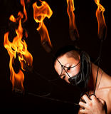 Asian man with fire show Royalty Free Stock Images