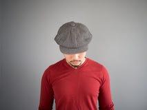 Asian man with flat cap. Stock Photos