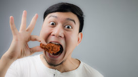 An Asian man with fried chicken. Stock Photo