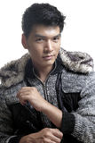 Asian man in fur and yarn texture jacket Royalty Free Stock Photography