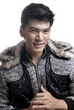 Asian man in fur and yarn texture jacket Stock Image