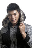 Asian man in fur and yarn texture jacket Royalty Free Stock Photos