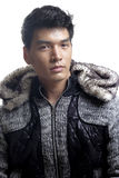 Asian man in fur and yarn texture jacket Stock Photo