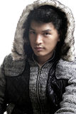Asian man in fur and yarn texture jacket Royalty Free Stock Images