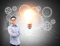 Asian man and gears with light bulb Stock Image