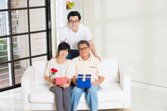 Asian man giving present. Asian men giving present to father and mother Stock Photos