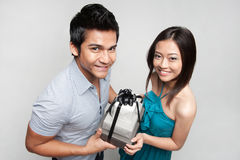 Asian man giving present to girl stock images