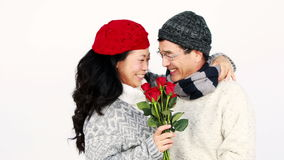 Asian man giving roses to his wife stock video footage