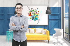 Asian man in glasses, office and light bulb Stock Photo
