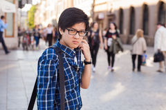 Asian man with glasses stand at street, closeup portrait. Royalty Free Stock Photos
