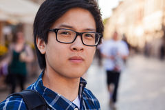 Asian man with glasses stand at street, closeup portrait. Stock Image