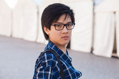 Asian man with glasses stand at street, closeup portrait. Stock Photo
