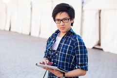 Asian man with glasses stand at street, closeup portrait. Royalty Free Stock Photo