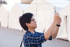 Asian man with glasses stand at street, closeup portrait. Stock Images