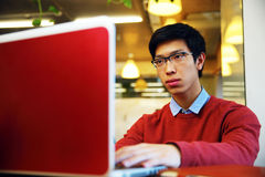 Asian man in glasses working on laptop Stock Photos