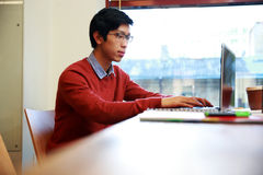 Asian man in glasses working on laptop Royalty Free Stock Photography