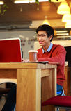 Asian man in glasses working on laptop Stock Image