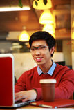 Asian man in glasses working on laptop Royalty Free Stock Photo