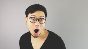 Asian man with grey background. Royalty Free Stock Photos