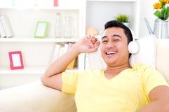 Asian man. Happy asian man with headphone Royalty Free Stock Photo