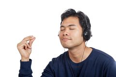 Asian man happy  listen to music do finger snapping. Isolated on white background Stock Photos
