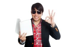 Asian man happy read a book show OK sign Stock Photos