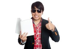 Asian man happy read a book show thumbs up Stock Image
