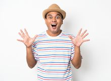 Young Asian man with hat feels shock and surprise with overly face expression. Asian man with hat feels shock and surprise with overly face expression royalty free stock photo