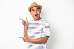Young Asian man with hat feels shock and surprise with overly face expression. Asian man with hat feels shock and surprise with overly face expression stock photography
